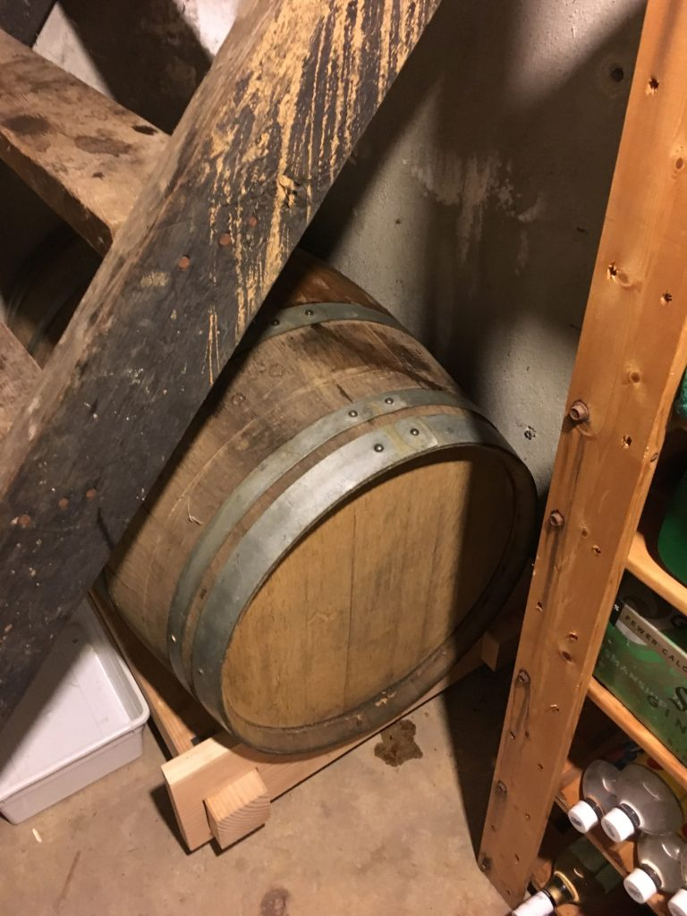 Barrel safely stowed under the basement stairs.